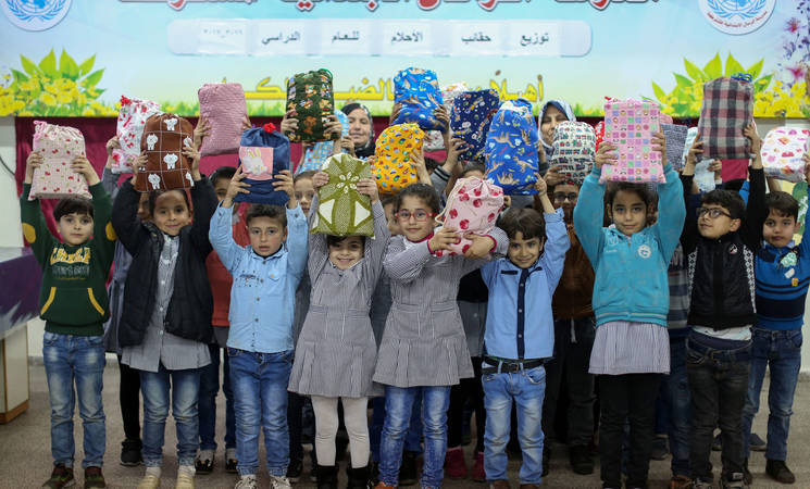 Students in UNRWA schools receive schools bags and stationary. © 2017 UNRWA Photo