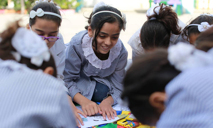 A Palestine child refugees drawing during a Community Mental Health Programme (CMHP) activity at Al-Amal Preparatory Girls in Khan Younis, southern Gaza . Photo credit: ©UNRWA Gaza 2017. Photo by Rushdi Al-Sarraj.