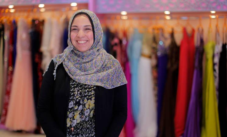 Thirty-nine-year-old Hanan Ahmed in her dress shop in Gaza City. © 2017 UNRWA Photo by Rushdi al-Saraj