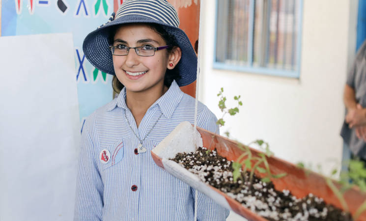 Hadeel Abu Tear, a 13-year-old UNRWA student during her participation in the Expo Tech corner of Agriculture and Environment in Khan Younis. © 2017 UNRWA Photo by Tamer Hamam