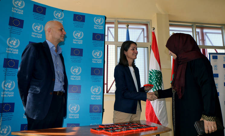 The Head of the Delegation of the European Union to Lebanon, Ambassador Christina Lassen, and the Director of UNRWA Affairs in Lebanon, Claudio Cordone, hand over keys to Palestine refugee families to celebrate their return to Nahr el Bared camp, Lebanon. © 2017 UNRWA Photo by Maysoun Mustafa