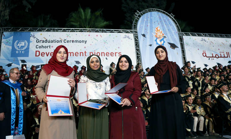 (From left) Dina Al Halabi, Lama Khattab, Amal Arayshi, and Falesteen Basyouni, Telecommunications graduates, after receiving their diplomas. © 2017 UNRWA Photo by Tamer Hamam