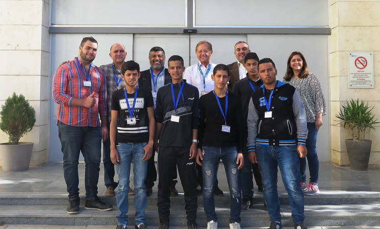 """To congratulate Ayman and his students for their efforts, the Director of UNRWA Operations in Jordan, Roger Davies (centre), met with Khaled Abu al-Hayja, Principal of WSTC, Ayman, Omar, Muhammad, Ali and other students. """"It is a true pleasure to meet you all today. I wish to thank the staff members following up on this anti-smoking awareness campaign"""" says Davies. © 2017 UNRWA Photo"""