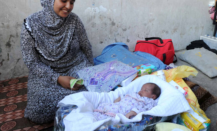 UNRWA issues maternity packs to new mothers taking refuge in its shelters