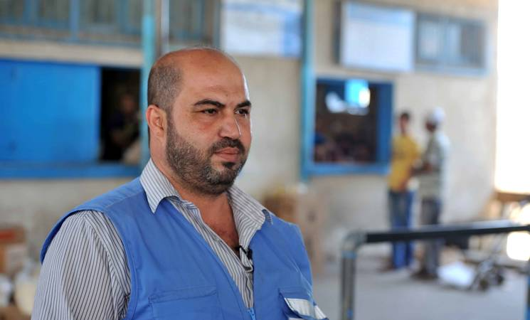 Riyad El-Lulu is responsible for UNRWA's food distribution center in Nuseirat, one of the Agency's 12 centers in the Gaza Strip.