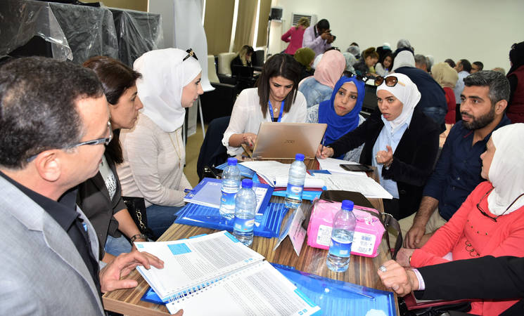 Participants share best practices in providing psychosocial support to Palestine refugee children in UNRWA schools at a capacity building workshop for Psychosocial Support Counsellors held at UNRWA Damascus Training Centre, Syria © 2018 UNRWA photo by Iyad Faouri.
