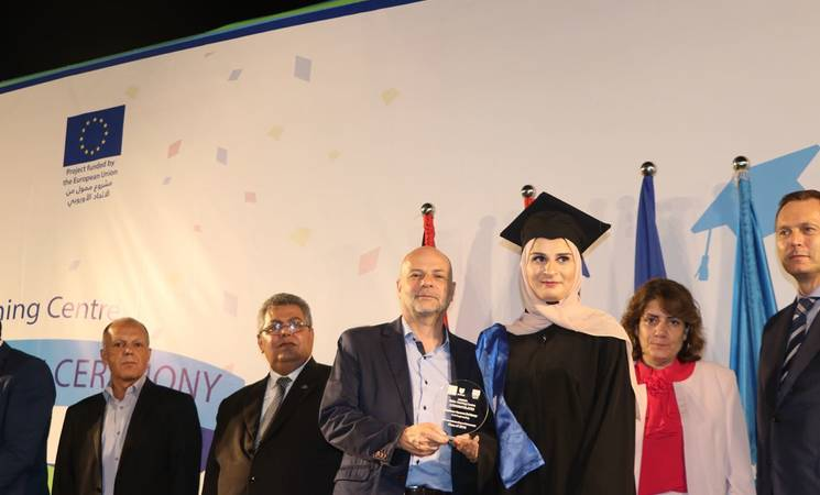 The Director of UNRWA Affairs in Lebanon, Claudio Cordone, Director General of the Technical and Vocational Education and Training Programme in Lebanon, Ms. Salam Younes, EU representative, Mr. Rein Nieland, representative of the Palestinian Ambassador to Lebanon, Mr. Maher Meshayel distributing diplomas at the end of the ceremony to the graduates of the class of 2018 at the Siblin Training Centre. ©2018 Photo for UNRWA