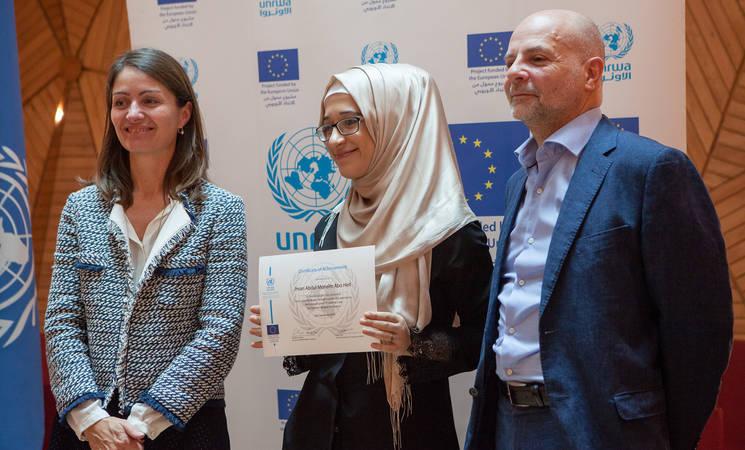 A graduate poses for a photo with Director of UNRWA Affairs in Lebanon, Claudio Cordone, and the Ambassador of European Union in Lebanon, Christina Lassen. © 2018 UNRWA Photo by Jesse Thompson