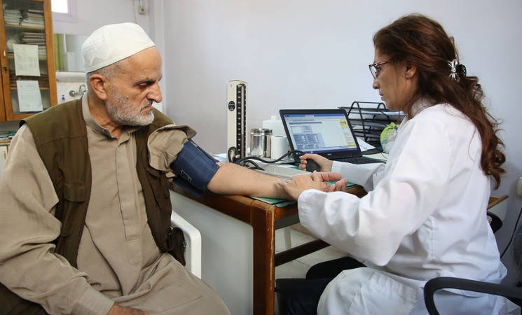 Abdallah Mohammad, an old Palestine refugee receives primary health care at UNRWA health centre in Alliance, Damascus @2018  UNRWA photo by Taghrid Mohammad.