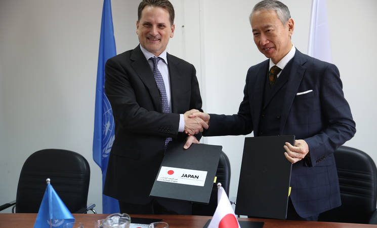 UNRWA Commissioner-General Pierre Krähenbühl and Ambassador Okubo signing ceremony for two Japanese contributions.   © UNRWA 2018 Photo by Marwan Baghdadi