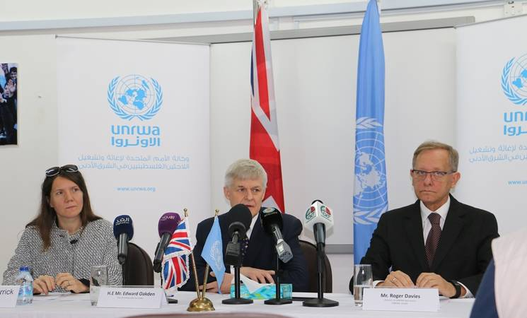 The Ambassador of the United Kingdom to Jordan, the head of DFID Jordan, and the Director of UNRWA Operations in Jordan photographed during the multi-year agreement signing ceremony held at the UNRWA Amman New Camp.  © 2018 UNRWA Photo by Dania Al Batayneh