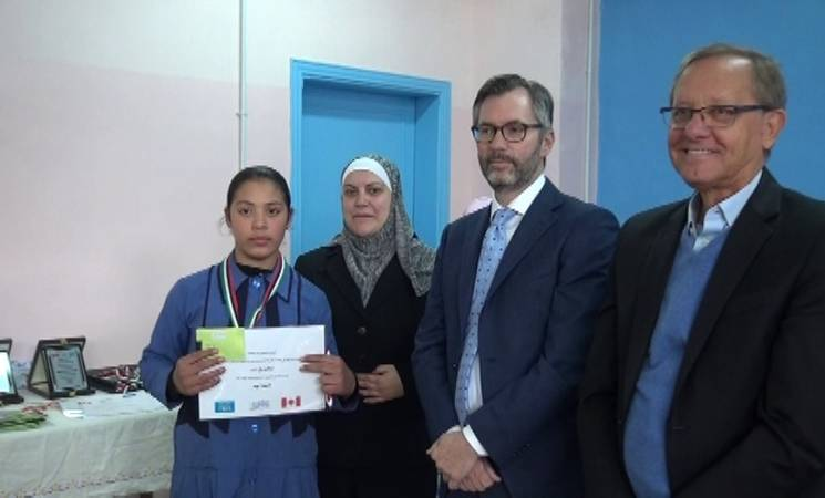the Ambassador of Canada to Jordan, H.E. Peter MacDougall with the Director of URNWA Affairs Jordan at the I Am a Leader ceremony © 2019 UNRWA Photo.