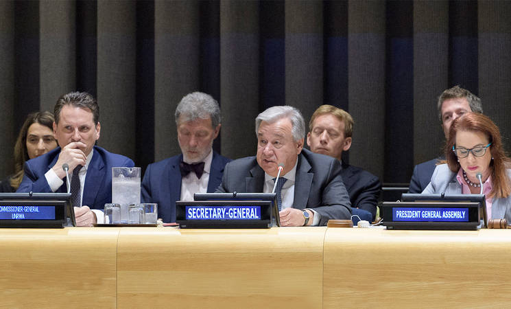 (From left) United Nations Relief and Works Agency for Palestine Refugees in the Near East (UNRWA) Commissioner-General Pierre Krähenbühl, United Nations Secretary-General António Guterres and President of the United Nations General Assembly  María Fernanda Espinosa address the 2019 UNRWA Pledging Conference at United Nations Headquarters in New York. 2019 UN Photo by Manuel Elias.