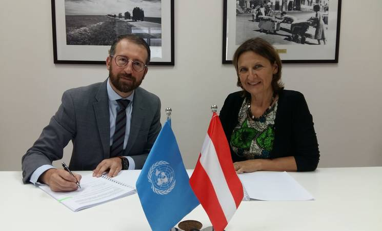 Marc Lassouaoui, Chief of Donor Relations UNRWA Department of External Relations and Communications signs the contribution agreement with Representative of Austria in Ramallah, Astrid Wein. © 2019 UNRWA Photo by Elisabeth Meyer