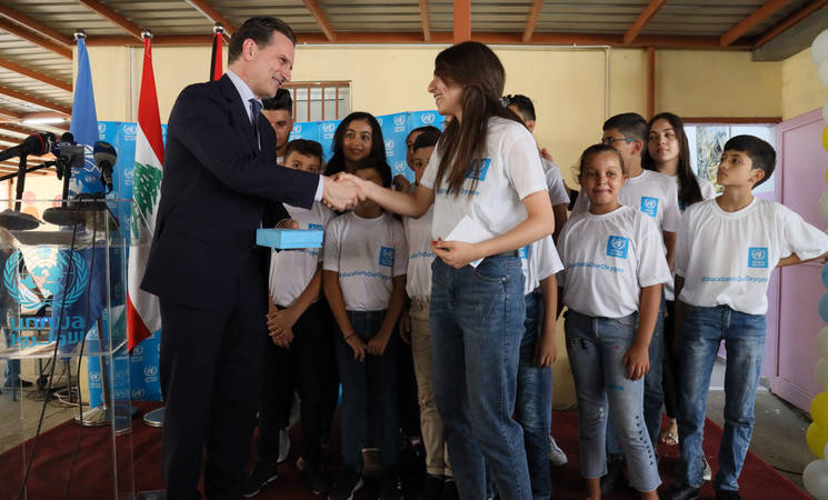 A student parliamentarian presents UNRWA Commissioner-General Pierre Krähenbühl with a 'box of dreams' during the first day of school ceremony at the UNRWA Yarmouk Girls' School in Beirut, Lebanon. © 2019 UNRWA Photo by Ramzi Haidar