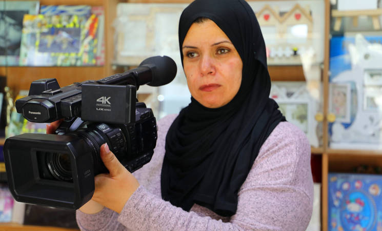 Wijdan Haroun pictured here during a shoot. © 2019 UNRWA Photo by Abeer Ismail.