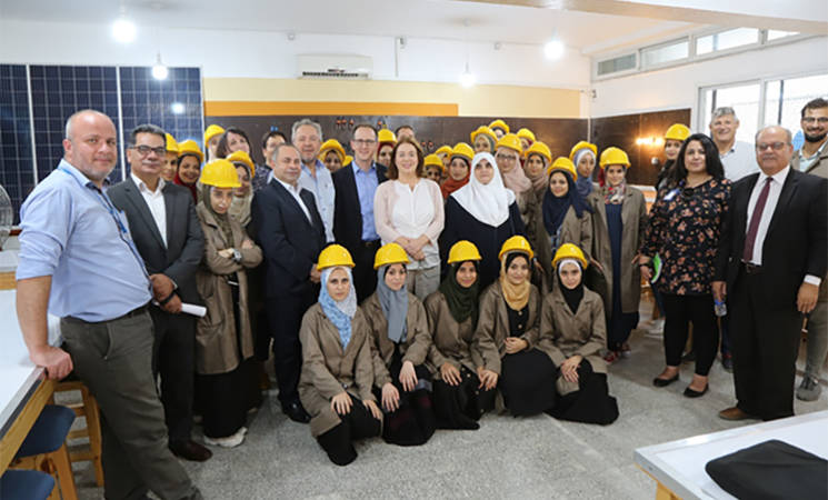 "The GIZ delegation accompanied by UNRWA senior staff meets with female trainees of the ""Installation and Maintenance of Solar Photovoltaic Systems"" course at the UNRWA Gaza Training Centre © 2019 UNRWA Photo by Khalil Adwan."