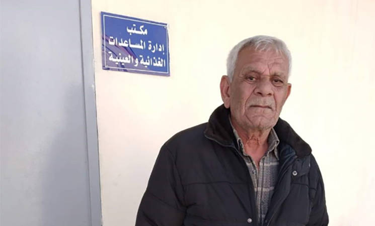 Mr. Ismaeel Abbas waiting for his assistance at an UNRWA cash distribution centre in Damascus. © 2019 UNRWA photo by Heba Hajjawi.