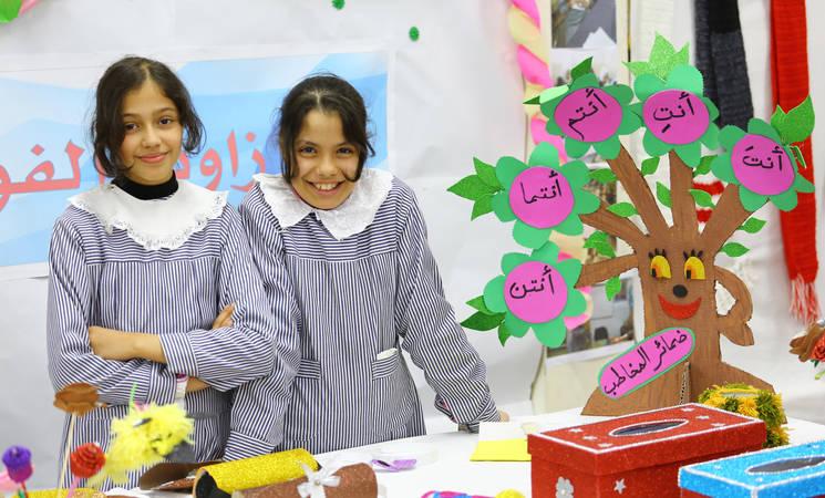 "Students from UNRWA Al Zaitoun Preparatory Girls' School ""C"" presenting their hand crafts products. © 2020 UNRWA Photo by Khalil Adwan."