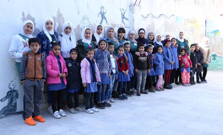 Student teachers and their little students from the UNRWA Jabal El-Hussein Basic School in Amman, Jordan. © 2019 UNRWA photo by Dania Al-Batayneh.