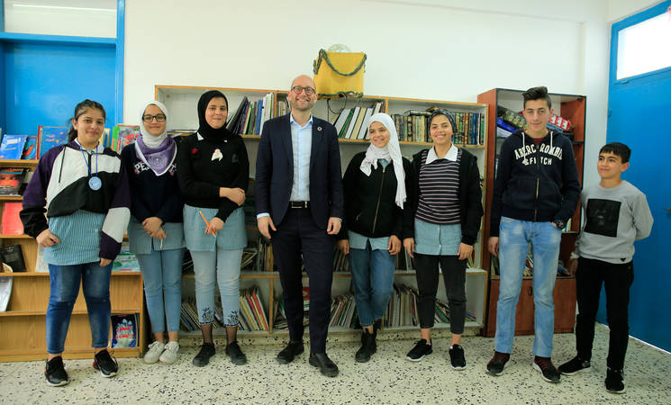 The Danish Minister for Development Cooperation (centre), Mr. Rasmus Prehn, met with student parliamentarians during his visit to the UNRWA Basic Girls' School in Jalazone refugee camp in Ramallah on 5 March 2020. © 2020 UNRWA Photo by Marwan Baghdadi.