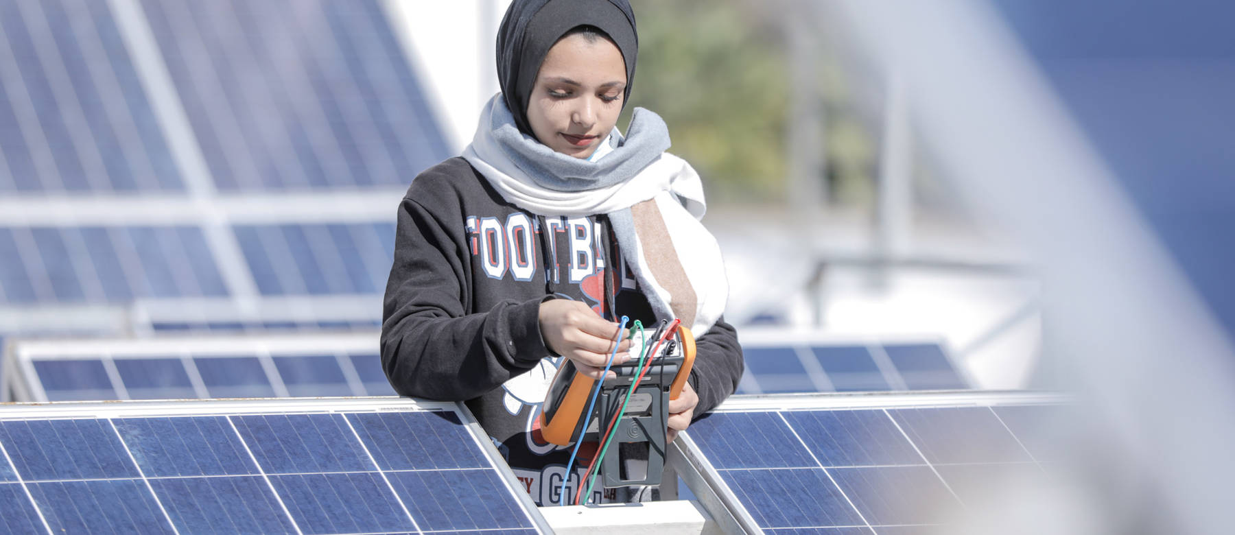 Ghada Krayem, a Palestine refugee, receiving vocational training on installation, operating, maintenance and programming of Solar Photovoltaic Systems at GTC.© 2021 UNRWA Photo by Mohammed Hinnawi