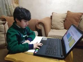 UNRWA student Omar Iyad Mohammed uses a distance learning platform from his home in Jabal el Hussein refugee camp, Jordan. © 2020 UNRWA photo