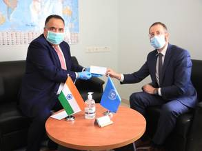 H.E. Sunil Kumar, the Representative of India to the State of Palestine (left),  hands over a check of US$ 2 million in support to UNRWA to the Chief of the UNRWA  Division of Donor Relations (right), Mr. Marc Lassouaoui, at the Agency's offices in East Jerusalem. © 2020 UNRWA Photo by Marwan Baghdadi
