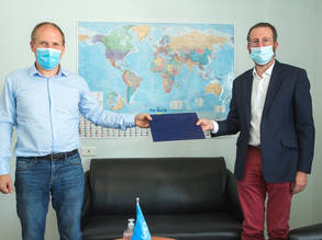 (From left) Jonas Blume, Director of KfW Ramallah - Al Bireh and Marc Lassouaoui, UNRWA Chief Donor Relations sign a contribution agreement to support Palestine refugees in Lebanon and Jordan. © 2020 UNRWA Photo by Marwan Baghdadi