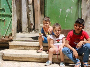 PRS children sit in front of their rented shelter in Beddawi refugee camp, Lebanon. © 2019 UNRWA Photo by Maysoun Mustafa