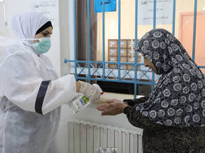 An UNRWA health staff member assists a Palestine refugee patient at the Am'ari Health Centre, West Bank. © 2020 UNRWA Photo