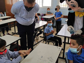 UNRWA Commissioner-General Philippe Lazzarini visits with students at the UNRWA Beit Jala Coeducational School on their first day back to learning. © 2020 UNRWA Photo by Kazem Abu Khalaf