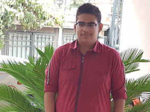 Mohammad Ibrahim at the UNRWA Area Office in Aleppo to celebrate his success in the ninth-grade exams. © 2020 UNRWA Photo