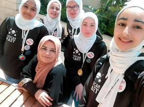 JFO teacher: UNRWA teacher Samar Nazzal photographed with her students. © 2019 UNRWA photo