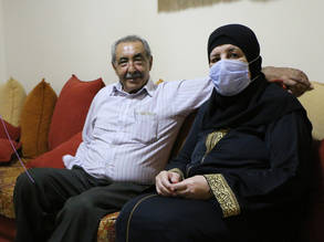 Buthaina Afana and her husband next to her. Buthaina a 59-year-old Palestine refugee from Nahr el-Bared Camp in Lebanon.