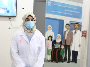 An UNRWA staff member at an UNRWA health centre in Gaza wearing personal protective equipment during the COVID-19 pandemic. © 2020 UNRWA Photo by Khalil Adwan