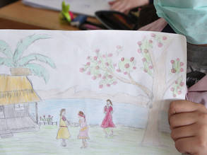 A young Palestine refugee student holds up a painting she drew at the UNRWA Qisaray Girls' School in Damascus, Syria. © 2020 UNRWA Photo