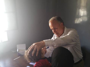 An UNRWA doctor examines a young child in Yalda, 27 August, 2015 ©UNRWA