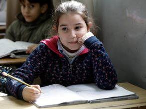 A Palestine refugee student displaced from Syria in class, Ramallah Elementary Coed School, Shatilla Camp, Lebanon. © 2013 UNRWA Photo