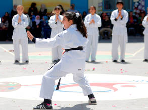 Palestine refugee students perform Karate during the Education in Emergencies project closing ceremony in Asma'a Preparatory Girls in Beach camp, western Gaza. © 2017 UNRWA Photo by Rushdi Al-Saraj