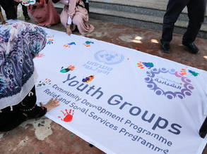 Palestine refugee youth participating in activities promoting peace and non-violence leave their handprint on the International Youth Day banner at the end of an open day for children held at Sharm Park, Gaza. © 2017 UNRWA Photo by Tamer Hamam