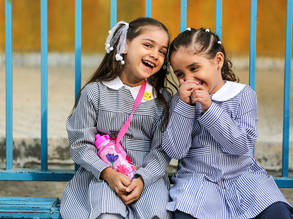 Two UNRWA students from Gaza enjoy recess in their first day of school. © 2017 UNRWA Photo by Rushdi Al-Saraj