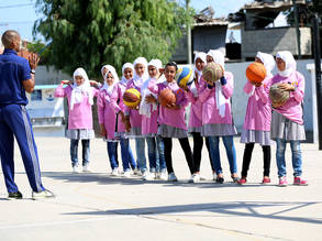 Students from Al-Bureij Preparatory Girls School B during a basketball training session, organized as part of UNRWA 'Empowering Young Girls through Sport' initiative implemented by the UNRWA Relief and Social Services Programme in a number of UNRWA schools across the Gaza Strip. © 2017 UNRWA Photo by Khalil Adwan