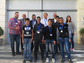 "To congratulate Ayman and his students for their efforts, the Director of UNRWA Operations in Jordan, Roger Davies (centre), met with Khaled Abu al-Hayja, Principal of WSTC, Ayman, Omar, Muhammad, Ali and other students. ""It is a true pleasure to meet you all today. I wish to thank the staff members following up on this anti-smoking awareness campaign"" says Davies. © 2017 UNRWA Photo"