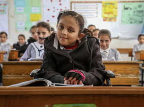 Zena Z Ghalban (10) takes a seat among her classmates at the UNRWA Maen Elementary Girls School in Khan Yunis.  © 2018 UNRWA Photo by Khalil Adwan