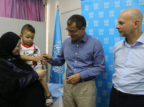 The German Ambassador to Lebanon, Martin Huth, and the Director of UNRWA Affairs in Lebanon, Claudio Cordone, hand over keys to Palestine refugee families to celebrate their return to Nahr el-Bared camp, Lebanon. © 2018 UNRWA Photo by Maysoun Mustafa