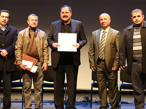 Mr. Mutaz Ghatash, an UNRWA teacher stands alongside the Palestinian Minister of Education, Dr. Sabri Siadam and other ministry staff members during the award ceremony of the President Mahmoud Abbas Award for Creativity and Distinction in the Palestinian Ministry of Education and Higher Education in Ramallah on December 15, 2018. Photo credit to Ministry of education