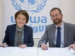 Her Excellency Anna-Kaisa Heikkinen, Ambassador and Head of the Finnish Representative Office in the occupied Palestinian territories (oPt) and the Chief of the UNRWA Donor Relations Division, Mr. Marc Lassouaoui formalize the renewal of a multiyear agreement to UNRWA in support of Palestine refugees. © UNRWA 2019 Photo by Marwan Baghdadi