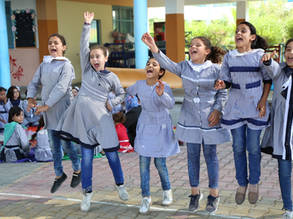 "Students from the UNRWA New Khan Younis Preparatory Girls' School, southern Gaza, cheer on their team during sporst and recreational activities of the UNICEF-funded project ""Keeping Kids Cool"", implemented in 47 UNRWA schools across the Gaza Strip. © 2018 UNRWA Photo by Khalil Adwan"