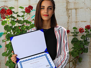 Rayan Abu Srour photographed with her certificate of appointment as the Permanent Ambassador to Palestine by Handong University. © 2019 UNRWA Photo by Abeer Ismail